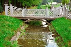 Wooden bridge over a small river in the park royalty free stock images