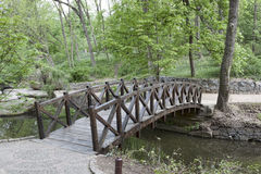Wooden bridge over a small river in Sophia park in Uman Stock Image