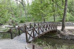 Wooden bridge over a small river in Sophia park in Uman Stock Image