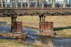Wooden bridge over a small river Stock Photo