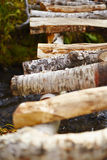 Wooden bridge over stream Royalty Free Stock Photography