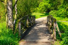 Wooden bridge over the stream Royalty Free Stock Photos