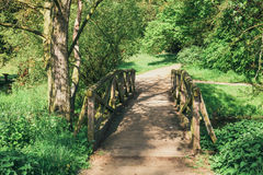 Wooden bridge over the stream Stock Photo
