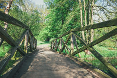 Wooden bridge over the stream Stock Photography