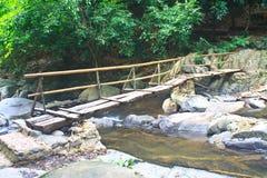 Wooden bridge over the stream Royalty Free Stock Photo