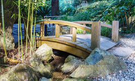 Wooden bridge over a stream Stock Photo