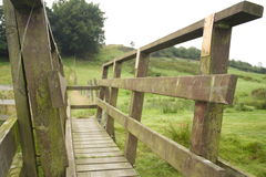 Wooden bridge over stream in Lancashire, UK Royalty Free Stock Images
