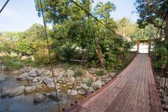 Wooden bridge for over the stream Stock Photo