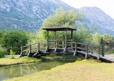 Wooden bridge over a stream Royalty Free Stock Photography