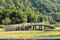 Wooden bridge over a stream Stock Image