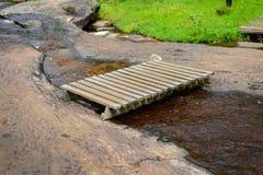 Wooden bridge over the stream Stock Image
