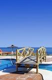 Wooden bridge over swimming pool in Spanish urbanisation Stock Images