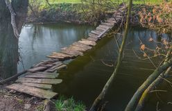 Free Wooden Bridge Over The River Stock Photos - 37905443