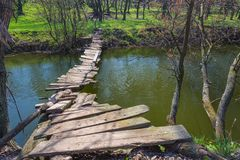 Free Wooden Bridge Over The River Royalty Free Stock Photo - 38446345
