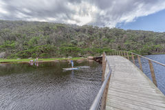 Wooden bridge over Tidal River Royalty Free Stock Photos