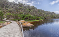 Wooden bridge over Tidal River and the river bank royalty free stock image
