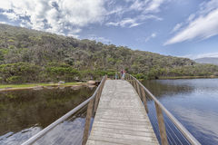 Wooden bridge over Tidal River Stock Photo