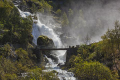 Wooden bridge over the waterfall stock photography
