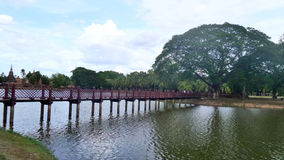 Wooden bridge over wide lake Stock Images