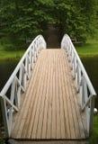 Wooden bridge in park. White wooden bridge in park Stock Photo