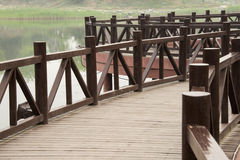 The wooden bridge. The park, brown wooden bridge and lake Stock Photo
