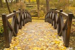 Wooden bridge in a park Stock Images