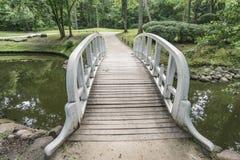 Wooden bridge in park stock photos