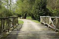 Wooden bridge in a park Royalty Free Stock Photos