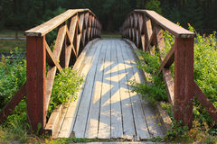 Wooden bridge. In the park on a sunny summer day Stock Photography