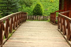Wooden bridge. In the park there is a small wooden bridge Royalty Free Stock Image