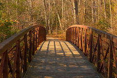 Wooden Bridge in the Park. A wooden bridge for walking in a nature preserve Stock Photos