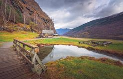 Wooden bridge on a path to the fjord shore Royalty Free Stock Images