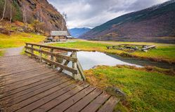 Wooden bridge on a path to the fjord shore Stock Photos