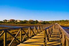 Wooden Bridge - Pedestrian Walkway - Perspective. Wooden bridge that connect Quinta do Lago or Lake Resort and Gigi Beach. Protected area Ria Formosa, Algarve Stock Photography