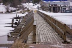 Wooden bridge in town of Priozersk at Vuoksa river royalty free stock photo
