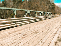 The wooden bridge. Photo taken on a wooden bridge in a row in the countryside stock photos