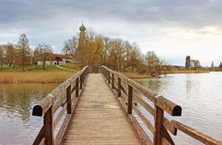 Wooden bridge in pictorial landscape. Lake seeon, germany Stock Image
