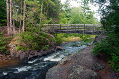 Wooden bridge at the Pike River, Marinette County,Wisconsin, USA. Wooden bridge over the Pike River near Dave`s falls, Marinette County, Wisconsin, USA stock image