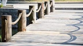 Wooden bridge pile Stock Photo