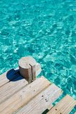 Wooden bridge and pristine sea Royalty Free Stock Photo