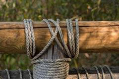 Wooden bridge. Rail and post of wooden bridge tight together by rope knot Stock Photo