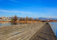 Wooden bridge between Rapperswil and Hurden in Switzerland Royalty Free Stock Images