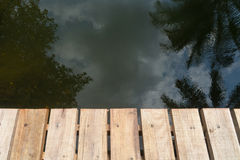 Wooden bridge and reflection Stock Image