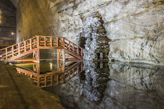 Wooden bridge reflexion in underground salt mine Royalty Free Stock Images