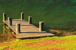 Wooden bridge in the reservoir Stock Images