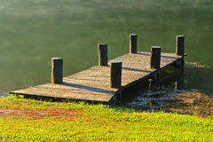 Wooden bridge in the reservoir Stock Image