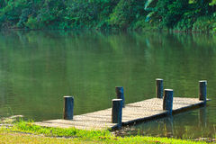 Wooden bridge in the reservoir Stock Photos