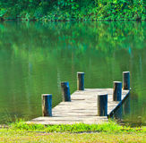 Wooden bridge in the reservoir Stock Photography