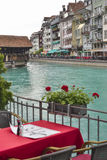 Wooden  bridge and restaurant table. Switzerland. Royalty Free Stock Photography