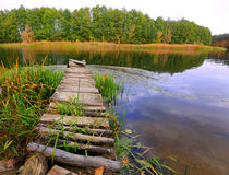 Wooden bridge on river Stock Photo